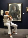 Jan Krugier in 2006, with a painting by Picasso.